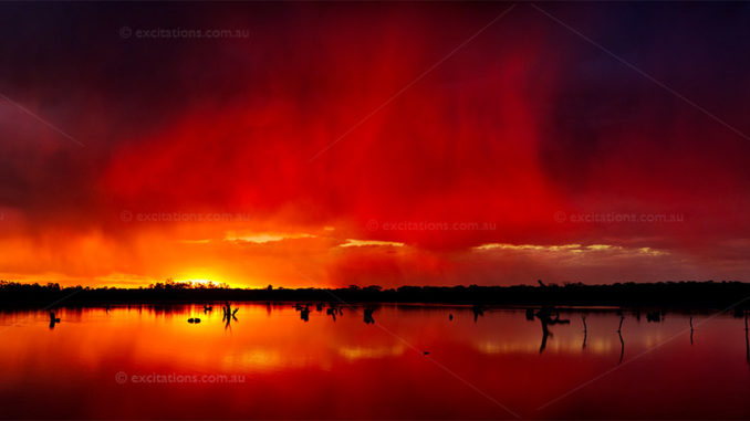 Stunning stock photo of red sunset summer rains over a outback salt lake. Stock Photos and videos of Australia by Excitations.